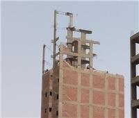 صور  الجيزة تزيل 5 أبراج و 15 عقارا مخالفا بالاحياء والمراكز