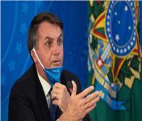 شكوى قضائية ضد رئيس البرازيل بسبب نزعه الكمامة بشكلٍ علنيٍ