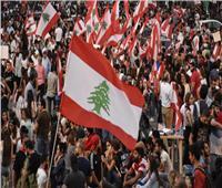 متظاهرون لبنانيون يرشون وزيرة العدل بالماء| فيديو