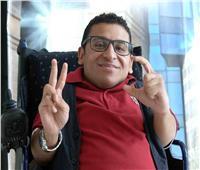 أحمد رأفت.. من الكرسي المتحرك لرئاسة قسم الجرافيك بـ«الوطنية للمعارض والمؤتمرات الدولية»