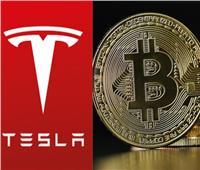«تسلا» تعتمد عملة البيتكوين في شراء السيارات الكهربائية