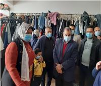 توزيع 30 ألف قطعة ملابس على الأسر الأولى بالرعاية بكفر الدوار.. صور