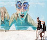 «مها» رسمت 200 شخص في جدارية واحدة وعينها على موسوعة جينيس