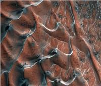 ناسا: تكوّن كثبان رملية نتيجة ذوبان الجليد على كوكب المريخ