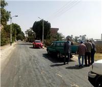 رصف شوارع مساكن الفتح بأسيوط واستكمال الطريق الجديد