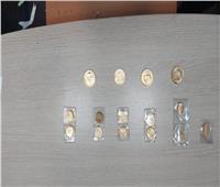 «مطار القاهرة» ضبط محاولة تهريب عدد من الجنيهات الذهبية والأقراص المخدرة