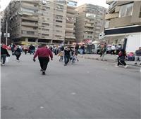 رفع الإشغالات وإعادة الانضباط لشارع العريش بالجيزة| صور