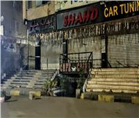 شاهد.. «كاميرا بوابة أخبار اليوم» تتابع تنفيذ مواعيد الغلق بشوارع الجيزة
