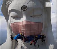 اليابان تضع كمامة تزن 35 كيلو على وجه تمثال عملاق| الفيديو