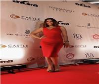 ألفت عمر تتألق بفستان أحمر فى حفل مجلة «إنيجما»