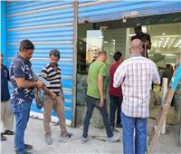 ضبط أعمال إنشاءات داخلية مخالفة بمحل تجاري ببولاق الدكرور.. صور