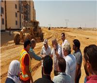 مسئولو الإسكان يتفقدون أعمال الطرق وتنسيق الموقع بمدينة حدائق العاصمة