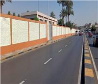 محافظة الجيزة تواصل دهان سور شارع السودان| صور