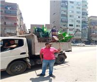 حملة إشغالات وكلبشة السيارات المخالفة في بولاق الدكرور |صور