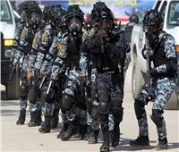الداخلية العراقية تعتقل 3 اشخاص بينهم امرأة تحمل كلاشينكوف