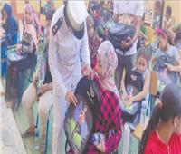 حقائب مدرسية مجانية بعزبة الهجانة من «كلنا واحد»