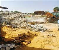 إزالة 25 حالة تعدي وبناء مخالف بالجيزة | صور