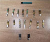 جمارك «مطار القاهرة» تضبط عدداً من الزجاجات المعبأة بسائل الماريجوانا المخدر