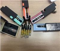 ضبط 12 زجاجة زيت الماريجوانا داخل حقائب راكب أمريكى بمطار القاهرة