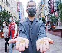 فنان صيني يبتكر فكرة جديدة لعرض مشكلة إهدار الطعام فى النفايات