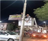 حملات مكثفة لإزالة الإعلانات العشوائية بشوارع وميادين المنصورة