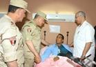 «حجازي» يطمئن على مصابي العمليات الإرهابية بمستشفيات القوات المسلحة