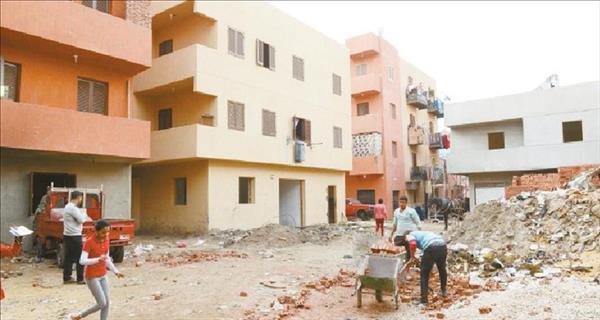 تطوير العسال يحولها لمنطقة سكنية آمنة «تصوير : حسن يوسف»