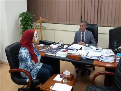 رئيس مركز المعلومات بمجلس الوزارء مع محررة بوابة اخبار اليوم