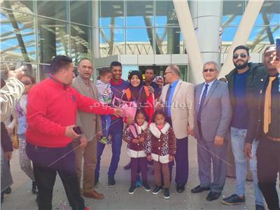 نعمة سعيد بطلة العالم لرفع الأثقال تصل القاهرة