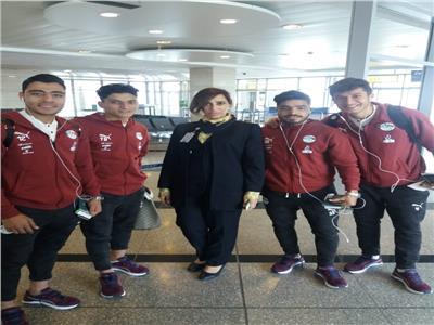 لاعبو المنتخب الأوليمبي خلال مغادرة مطار القاهرة