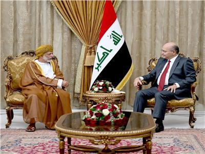 الرئيس العراقي برهم صالح خلال استقباله وزير الخارجية العماني يوسف بن علوي