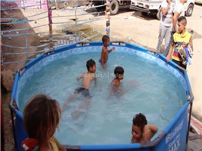 أطفال الدويقة يستمتعون في «بورتو» سعيد