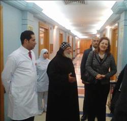 وزيرة التخطيط تزور مصابي كنيسة حلوان في معهد ناصر
