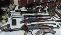ضبط أسلحة ومخدرات وهاربين من أحكام في حملة مكبرة بالجيزة