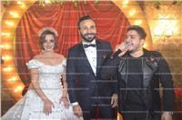 صور| العسيلي ومصطفى حجاج يغنيان لـ«أحمد وريهام» في زفافهما