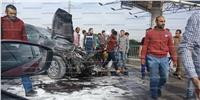 بالصور| تصادم وحريق سيارة على محور 26 يوليو