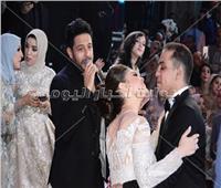 صور| حماقي وبوسي وأوكسانا يتألقون في زفاف «أحمد وآلاء»
