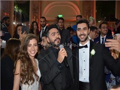 صور| زفاف «مصطفى وفريدة» بتوقيع تامر حسني