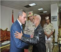 صور  محافظ أسيوط يكرم أسر شهداء القوات المسلحة