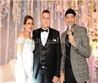 صور| كاريكا يُشعل زفاف «باسم ورنا» بـ«روميو»