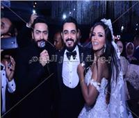 صور| تامر حسني والليثي وجوهرة يشعلون زفاف «عماد وديان»