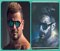 صور| حماقي «ينحت» بوستر ألبومه الجديد من عمرو دياب