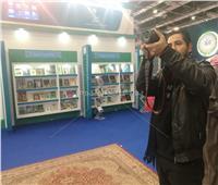 صور| لافتة «السيسي» و«سلمان» الأكثر جذبًا لعشاق التصوير في معرض الكتاب