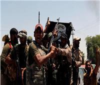 10 شاحنات تنقل مقاتلين داعش وأسرهم للعراق