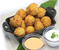 طبق اليوم ..  «كرات البطاطس بالبيض والبصل المكرمل على الطريقة الهندية»