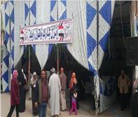 «أعرف لجنتك».. مقرات استعلام للأحزاب أمام اللجان بالإسكندرية