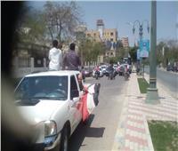 عمال شركة مطاحن مصر ينظمون مسيرة «في حب مصر» بالمنيا