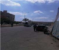 صور  سيارات تبث أغاني وطنية في الشيخ زايد لحث المواطنين على الاستفتاء