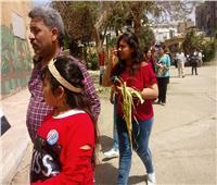 صور| الأحتفال بـ«عيد السعف» داخل اللجان الانتخابية بشبرا