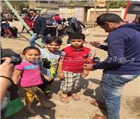 رسم العلم على وجوه الأطفال أمام اللجان بدار السلام